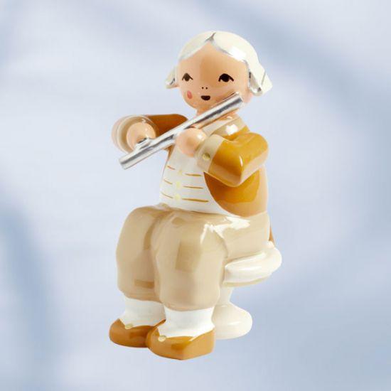 Musiker mit Querflöte, sitzend