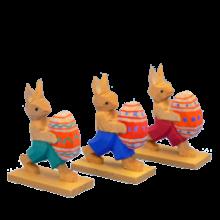 Hasengruppe mit Ei, laufend