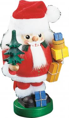 Nutcracker Santa Claus with tree and gifts.