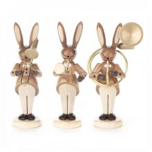 Rabbit trio with trombone, hunting horn and sousaphone, nature