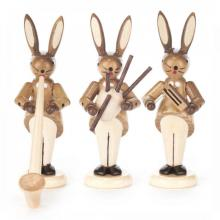 Rabbit trio with alphorn, bagpipe and rattle, nature
