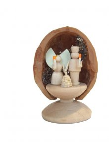 Miniature angel and miner in walnut shell, standing