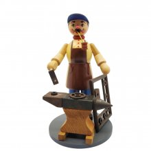 Smoking figure blacksmith with anvil