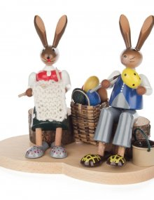 Pair of hares on a wooden trunk, colored