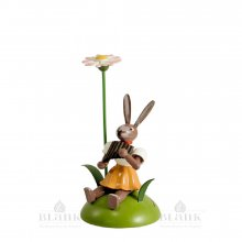 Blank Easter bunny sitting with daisies and pan flute