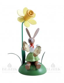 Blank easter bunny sitting with daffodil and basin