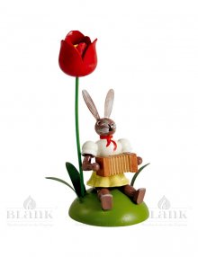 Blank easter bunny sitting with tulip and harmonica