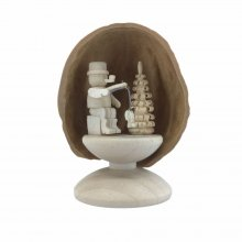Miniature angler in walnut shell, standing