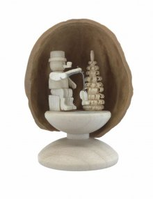 Miniature angler in walnut shell, standing