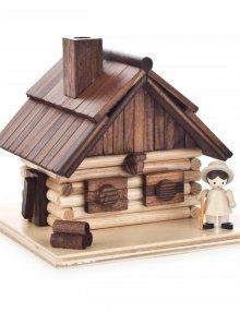 Smokehouse mountain hut with figure