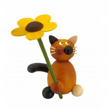 Calico cat Lilli with flower